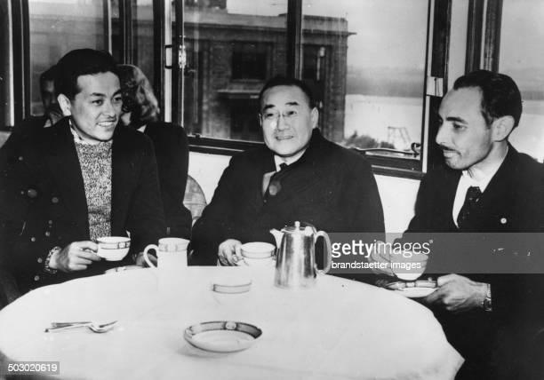 The Japanese record flyer Masaaki Inuma aand Kenji Tsukagoshi after their flight Tokyo London with the Japanese Ambassador Shigeru Yoshida London...