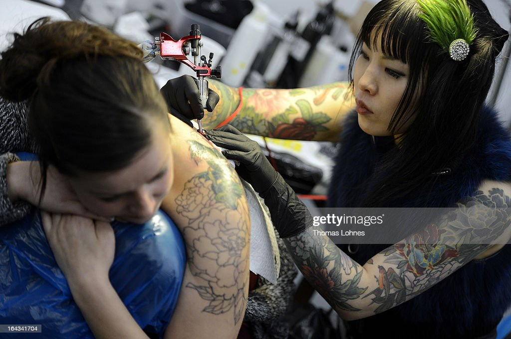 The Japanese tattoo artist Ryoko tattooes a young woman during the International Tatoo Convention on March 22, 2013 in Frankfurt am Main, Germany. The Frankfurt tattoo convention is considered the world's biggest fair for the art of tattooing. More than 700 artists from all over the world will make more than 3,000 tattoos at the three-day show. The Hessian state laboratory has found carcinogens in some tattoo inks produced in China, causing warnings to be issued Europe-wide.