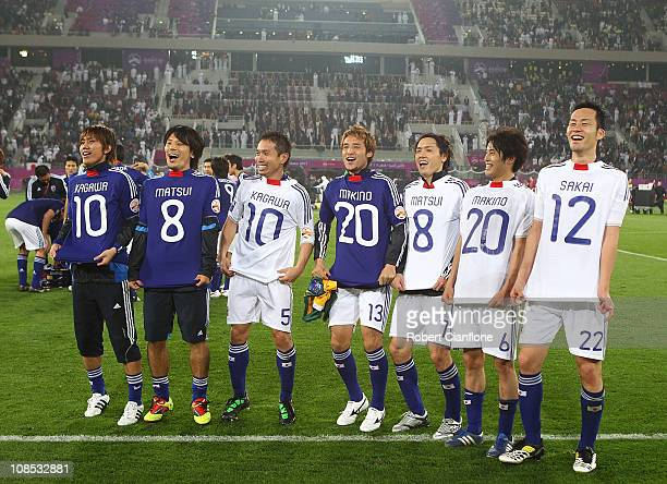 The Japanese team celebrate after Japan defeated Australia in extra time 10 at the AFC Asian Cup Final match between the Australian Socceroos and...