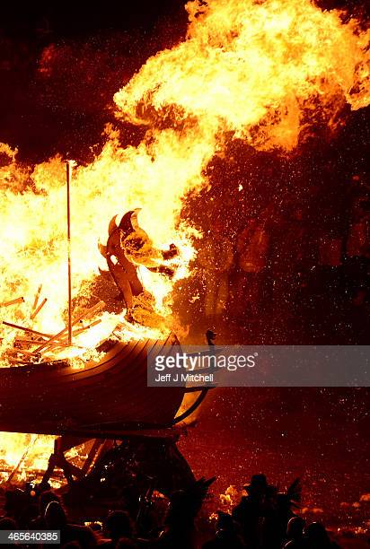 The Jarl Squad march around a Viking Longship before torching it on January 28 in the Shetland Islands Scotland The traditional festival of fire is...