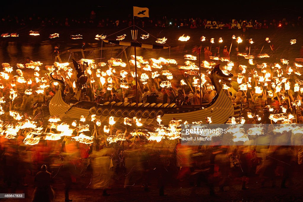 The Jarl Squad march around a Viking Longship before torching it on January 28, 2014, in the Shetland Islands, Scotland. The traditional festival of fire is known as 'Up Helly Aa'. The spectacular event takes place annually on the last Tuesday of January. The climax of the day comes with participants in full costume hauling a Viking longboat through the streets of Lerwick to the edge of town where up to 1000 paraders will throw their flaming torches into the galley.