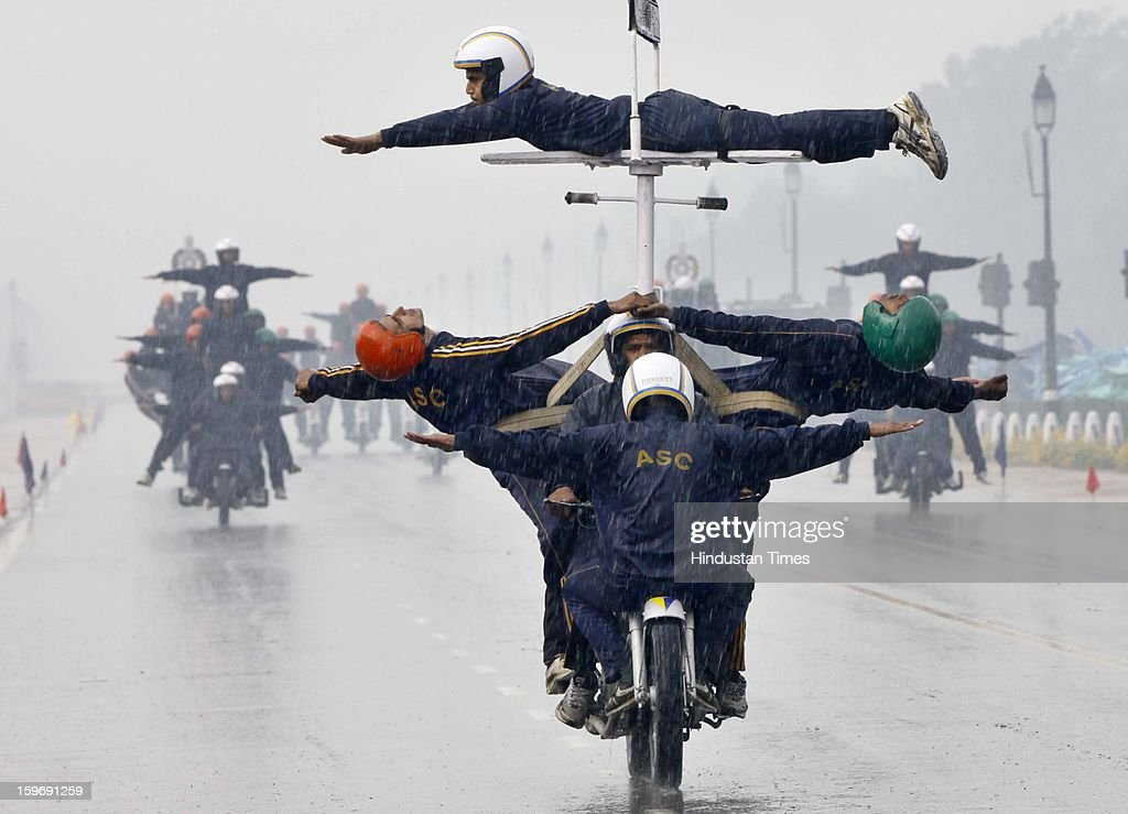 The Jawans performing motor cycle stunt in the rain and cold weather for the forthcoming National Festival Republic Day at Raj Path on January 18, 2013 in New Delhi, India.