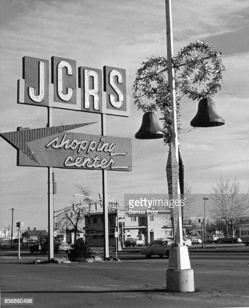 The JCRS Shopping Center made use of its light poles strong with silver garlands and touched off with large bells for its Christmas decorations...