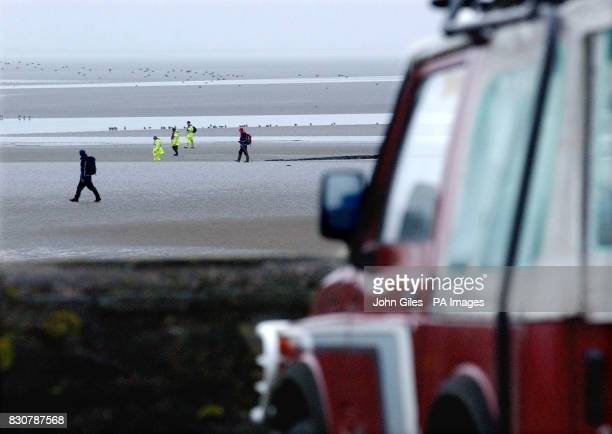 The jeep belonging to the drowned man is left where he parked the vehicle above the beach where search parties now hunt for his nine year old son who...