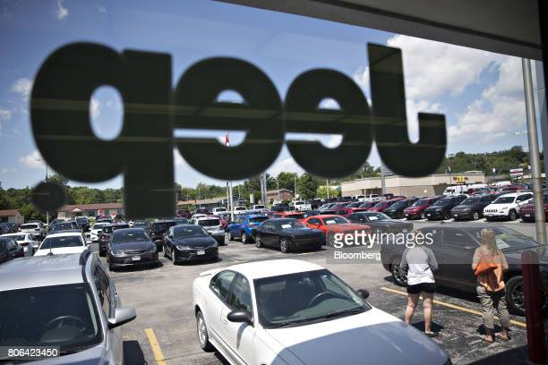 The Jeep logo appears on the window of a Fiat Chrysler Automobiles car dealership showroom in Moline Illinois US on Saturday July 1 2017 Ward's...