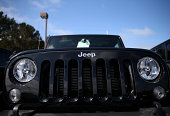 The Jeep logo is displayed on a brand new Jeep at Chrysler Jeep Dodge Ram Marin on September 3 2014 in Corte Madera California Chrysler Group...