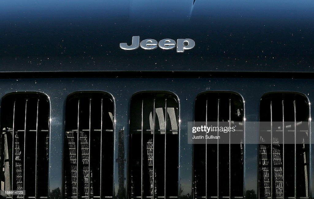 The Jeep logo is displayed on the front of a used car at a Chrysler dealership on January 3, 2013 in Colma, California. Chrylser and General Motors led automakers in the best sales year since 2007. Chrysler's December sales jumped 10% while GM's was up 4.9%.