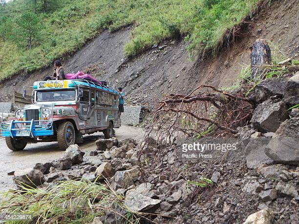 The jeepney passes through the road with landslide Heavy rains in Banaue Ifugao causes landslide in steep roads going to Bontoc Mountain Province...