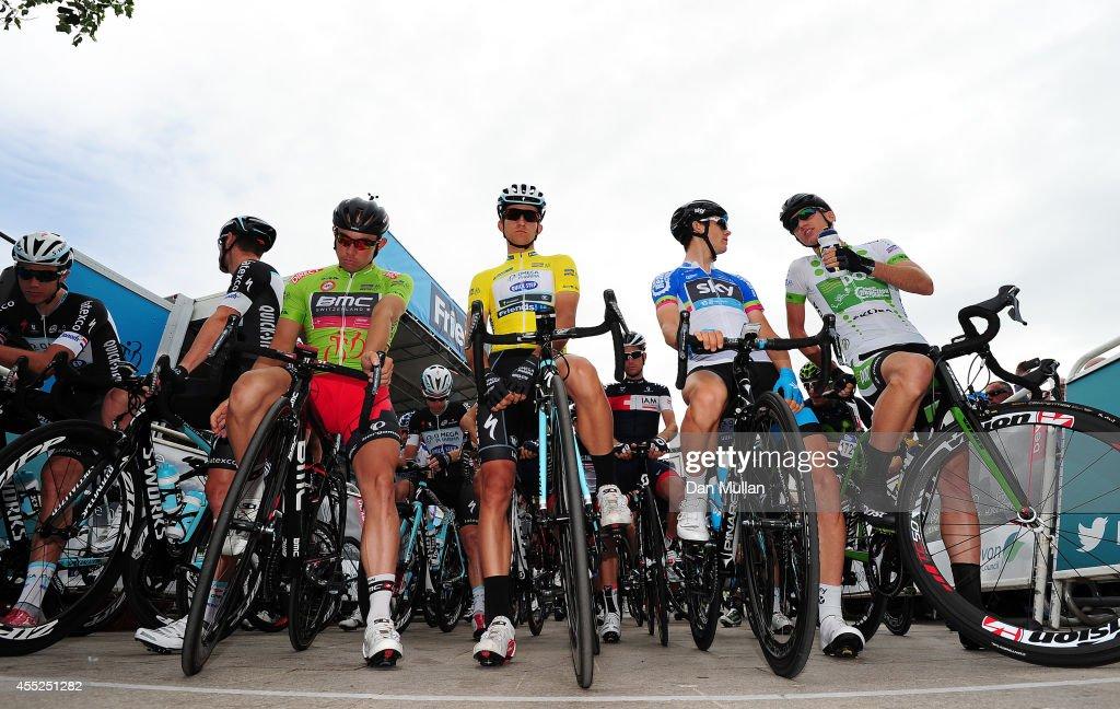 The jersey holders Sebastian Lander of Denmark and BMC Racing Team Michal Kwiatkowski of Poland and Omega Pharma QuickStep Ben Swift of Great Britain...