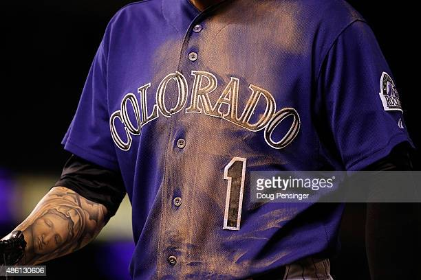 The jersey of Brandon Barnes of the Colorado Rockies exhibits the dirt of aggressive play against the Arizona Diamondbacks at Coors Field on August...
