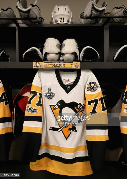 The jersey of Evgeni Malkin of the Pittsburgh Penguins hangs in the locker room prior to Game Four of the 2017 NHL Stanley Cup Final at Bridgestone...
