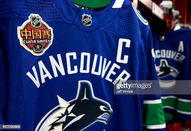 The jersey of Henrik Sedin of the Vancouver Canucks sports a China Games patch in the Vancouver Canucks locker room before the preseason game between...