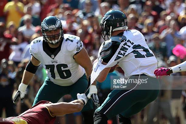 The jersey of quarterback Carson Wentz of the Philadelphia Eagles is torn by outside linebacker Ryan Kerrigan of the Washington Redskins in the first...