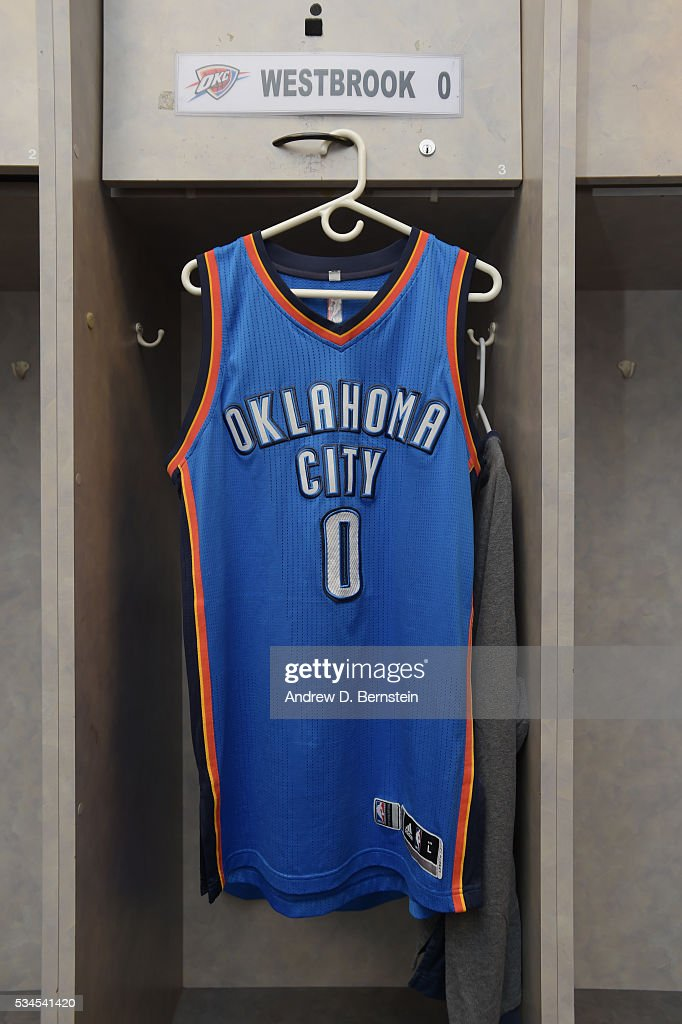 The jersey of <a gi-track='captionPersonalityLinkClicked' href=/galleries/search?phrase=Russell+Westbrook&family=editorial&specificpeople=4044231 ng-click='$event.stopPropagation()'>Russell Westbrook</a> #0 of the Oklahoma City Thunder in the locker room before Game Five of the Western Conference Finals against the Golden State Warriors during the 2016 NBA Playoffs on May 26, 2016 at ORACLE Arena in Oakland, California.