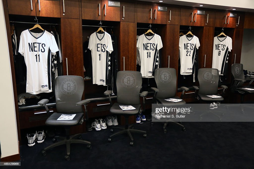 The jerseys of Brook Lopez Mason Plumlee Darius Morris Markel Brown and Alan Anderson of the Brooklyn Nets in the locker room before the game against...