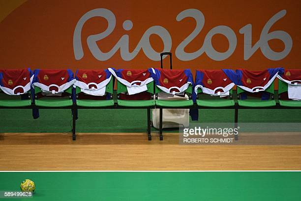 The jerseys of the Russian teams are displayed on the bench past the logo of Rio 2016 prior to the women's preliminaries Group B handball match...
