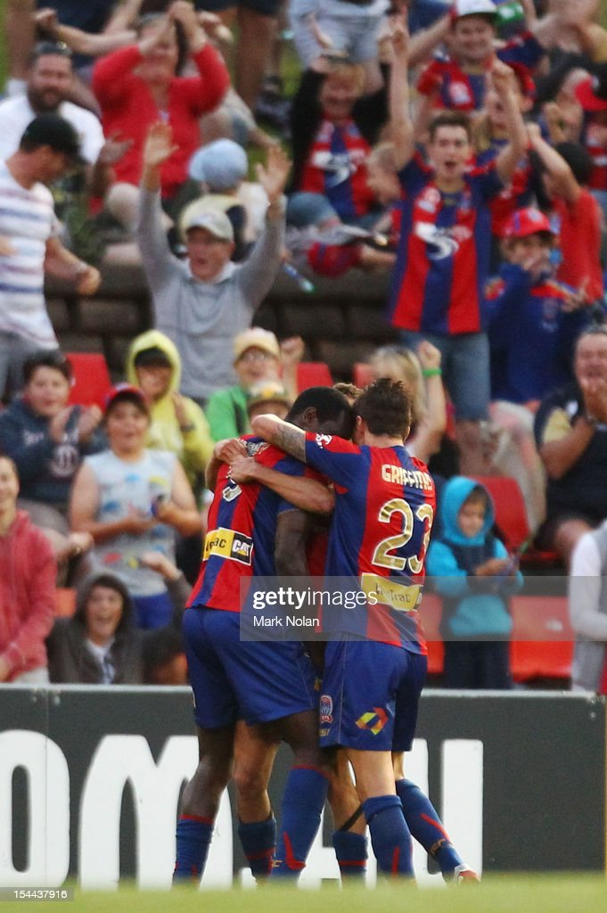 The Jets celebrate a goal by Emile Heskey during the round three ALeague match between the Newcastle Jets and the Central Coast Mariners at Hunter...