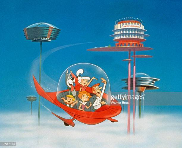 The Jetson family wave as they fly past buildings in space in their spaceship in a still from the animated television series 'The Jetsons' circa 1962