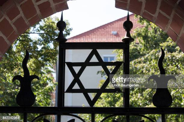 The Jewish cementery Prenzlauer Berg in Berlin The photo shows the Star of David at the entrance of the cementery