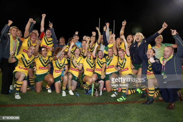 The Jillaroos celebrate victory during the women's ANZAC Test match between the Australian Jillaroos and the New Zealand Kiwi Ferns at GIO Stadium on...