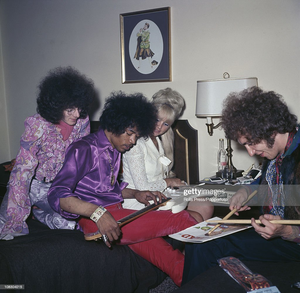 The Jimi Hendrix Experience and a blonde circa 1968 left to right Noel Redding Jimi Hendrix and Mitch Mitchell