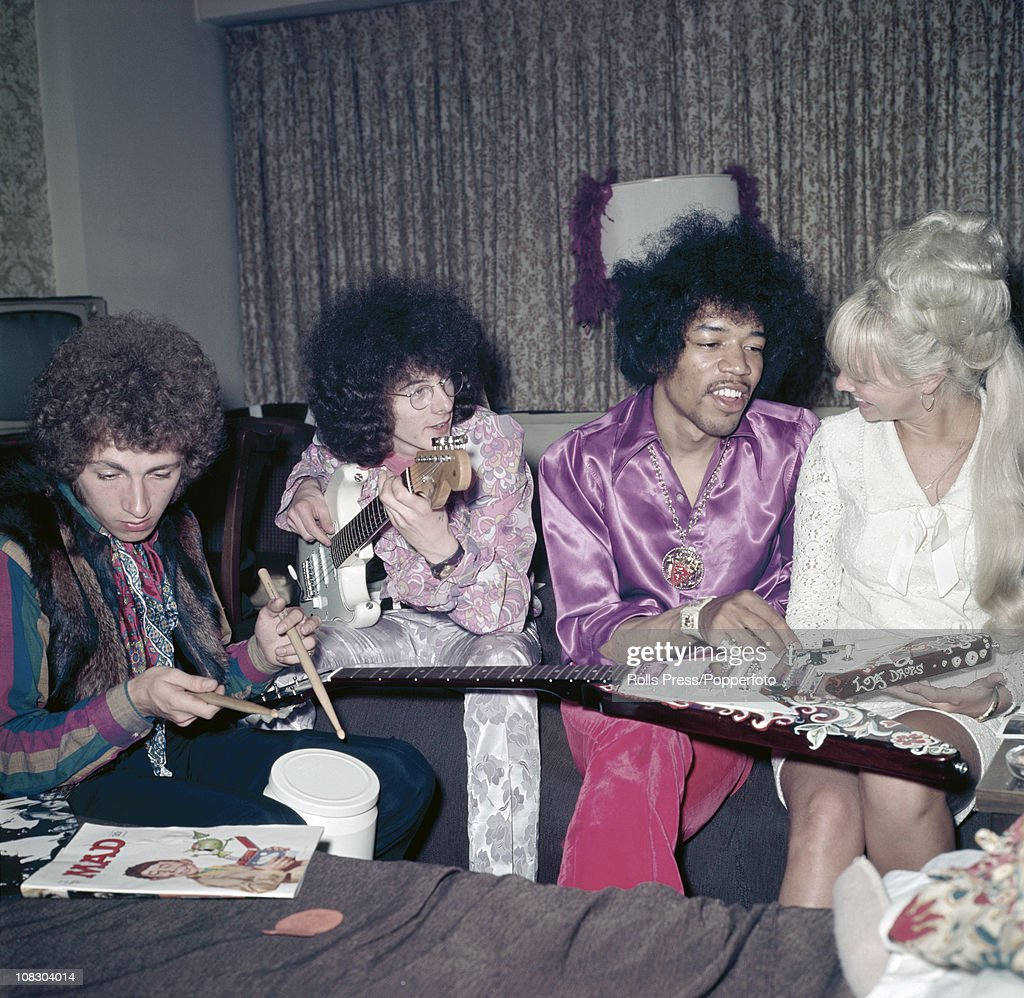 The Jimi Hendrix Experience circa 1968 left to right Mitch Mitchell Noel Redding and Jimi Hendrix with a blonde lady