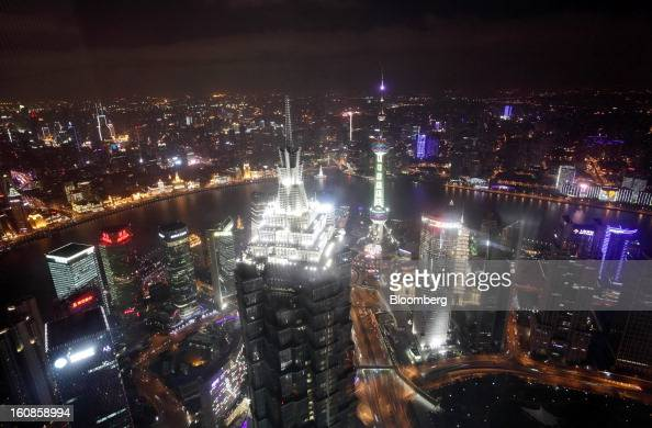 The Jin Mao Tower center left and the Oriental Pearl Tower center stand among other commercial buildings as seen from the Shanghai World Financial...