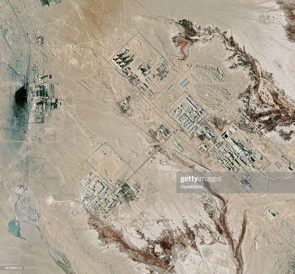 COMPLEX, YUMEN, CHINA - NOVEMBER 15, 2012 The Jiuquan Atomic Energy Complex (JAEC) is a large scale nuclear facility establised in 1958 near Yumen, China. This is an overview satellite image from November 15, 2012 in which continued development is visible in the northern and western portions of the complex, as well as road construction between the two facilities.