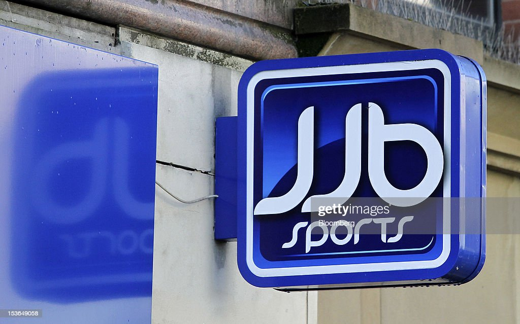 The JJB Sports Plc logo hangs over a closed down store in Manchester, U.K., on Saturday, Oct. 6, 2012. JJB Sports Plc, a U.K. sporting goods retailer, will close most of its stores with the remaining 20 being acquired by competitor Sports Direct International Plc, according to a statement from KPMG LLP, which was appointed as administrator to the Wigan, England-based company. Photographer: Paul Thomas/Bloomberg via Getty Images