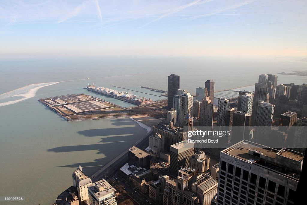The John Jardine Water Purification Plant(left) and Navy Pier, as photographed from the observatory deck of The John Hancock Center, in Chicago, Illinois on JANUARY