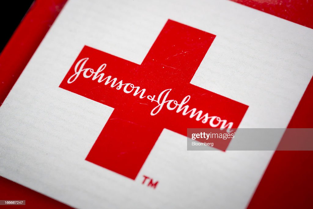 The Johnson & Johnson logo is arranged for a photograph in New York, U.S., on Monday, April 15, 2013. Johnson & Johnson is scheduled to release earnings data on April 16. Photographer: Scott Eells/Bloomberg via Getty Images