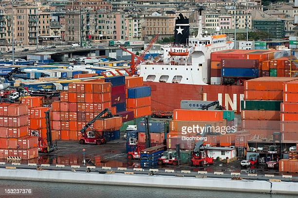 The Jolly Grigio dry cargo ship operated by Ignazio Messina C SpA sits moored between shipping containers and residential apartment blocks at the...