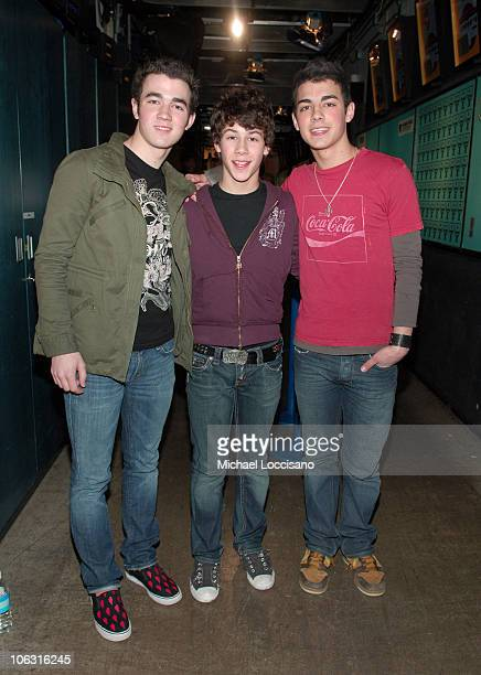 The Jonas Brothers during JoJo and The Jonas Brothers Visit MTV's 'TRL' March 1 2006 at MTV Studios Times Square in New York City New York United...