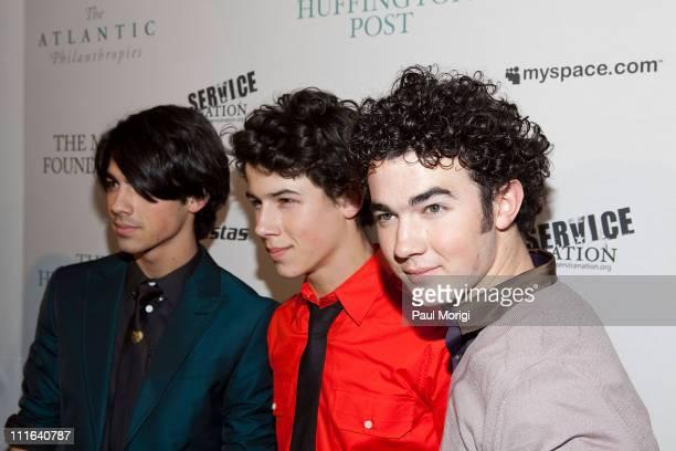The Jonas Brothers Joe Jonas Nick Jonas and Kevin Jonas arrive at The Huffington Post preinaugural ball at the Newseum on January 19 2009 in...