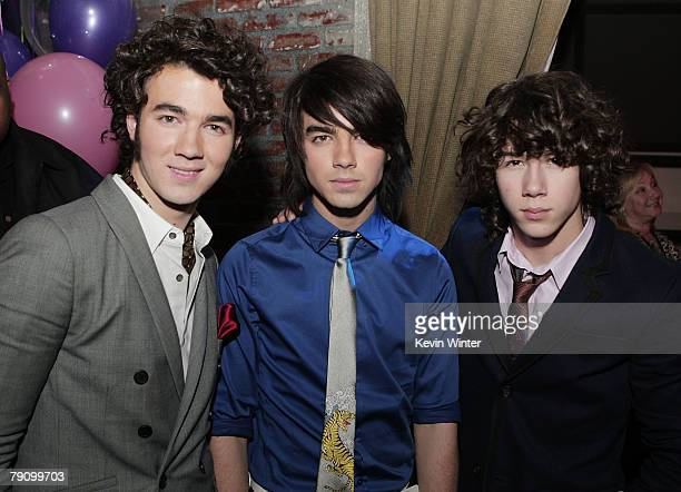 The Jonas Brothers Kevin Joe and Nick pose at the afterparty for the premiere of Walt Disney Pictures' 'Hannah Montana Miley Cyrus Best of Both...