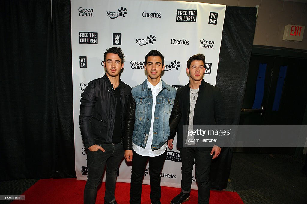The Jonas brothers pose during the red carpet before the We Day Minnesota event at the Xcel Energy Center in St. Paul, Minnesota on October 8, 2013