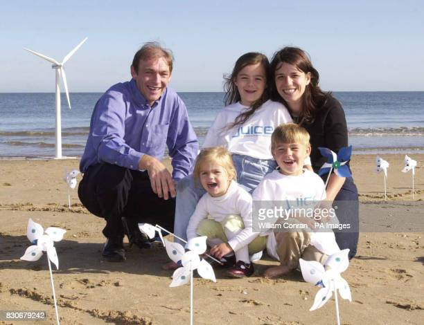 The Jones family from Prestatyn north Wales on the beach at Rhyl The family are the first customers to sign up for Juice a clean electricity product...