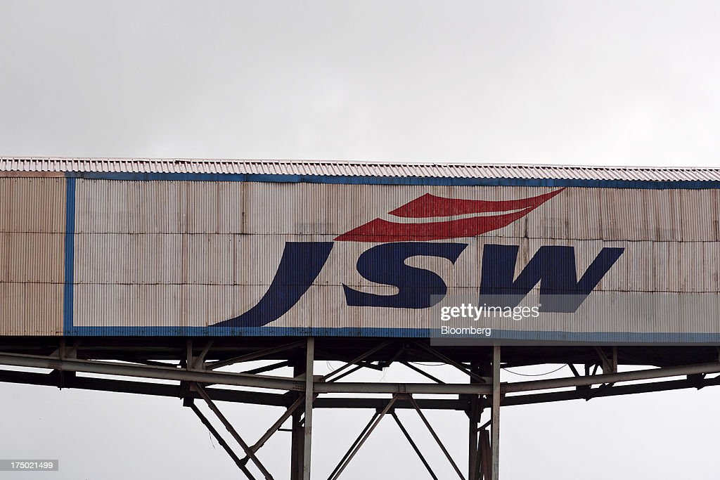 The JSW Steel Ltd. logo is displayed on an overhead conveyor at the company's manufacturing facility in Dolvi, Maharashtra, India, on Friday, July 27, 2013. JSW Steel is scheduled to announce first-quarter earnings on July 31. Photographer: Adeel Halim/Bloomberg via Getty Images