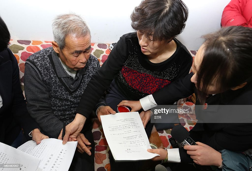 The judge of the higher people's court delivers retrial files to Hugjiltu's parents in Hohhot northern China's Inner Mongolia autonomous region on...
