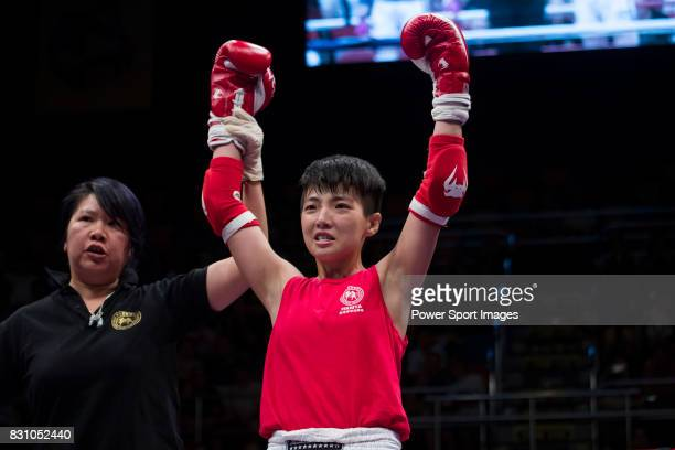 The judge rises the arm of Au Yin Yin Winnie of Hong Kong as she wins the gold medal in the female muay 51KG division weight final during the East...
