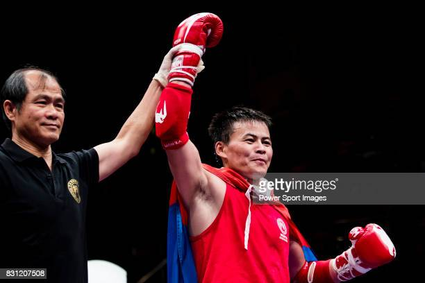 The judge rises the arm of Bayadaa Mendbayar of Mongolia as he wins the gold medal in the male muay 60KG division weight bout during the East Asian...