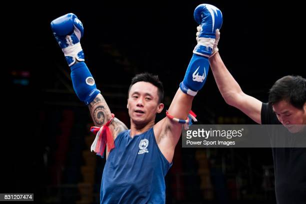 The judge rises the arm of Lui Chun Yin of Hong Kong as he wins the gold medal in the male muay 635KG division weight bout during the East Asian...