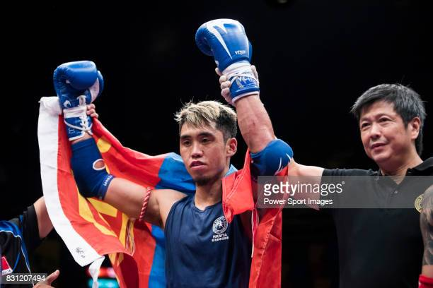 The judge rises the arm of Sundui Batjargal of Mongolia as he wins the gold medal in the male muay 67KG division weight bout during the East Asian...
