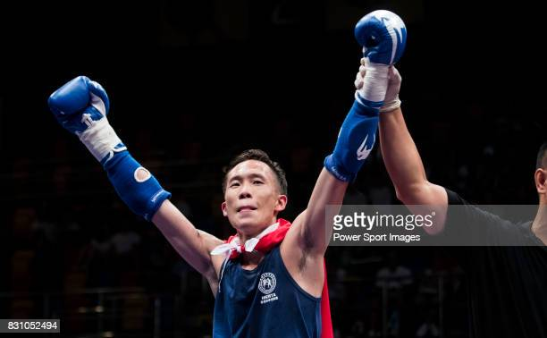 The judge rises the arm of Yeung Wai Lun of Hong Kong as he wins the gold medal in the male muay 51KG division weight bout during the East Asian...