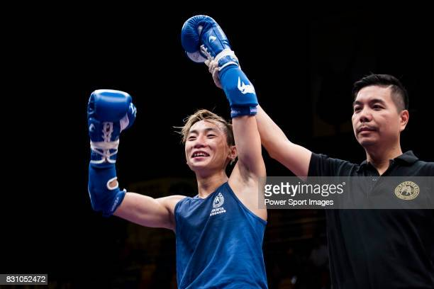 The judge rises the arm of Yiu Tat Fai of Hong Kong as he wins the gold medal in the male muay 48KG division weight final during the East Asian...