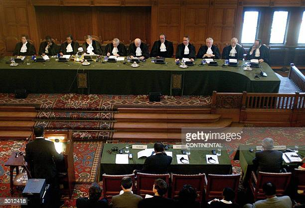 The judges at the International Court of Justice in The Hague 25 February 2004 listen to a member of the Sudanese delegation The court began its...