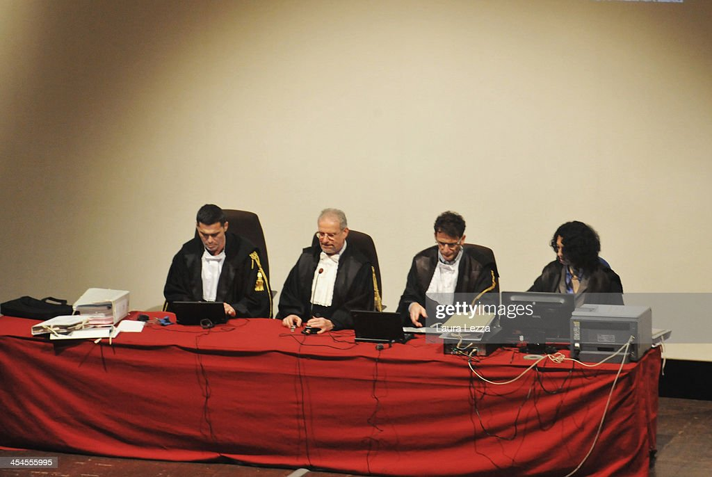 The judges get ready before the start of the hearing in the trial of the Costa Concordia on December 9, 2013 in Grosseto, Italy. Coastguard Captain Gregorio De Falco and Captain Francesco Schettino met for the first time in court today. De Falco, famous for ordering Schettino back onboard after he allegedly abandoned the ship with hundreds of passengers still onboard, took to the stand as a witness. The Costa Concordia capsized on January 13, 2012 leaving 32 people dead.