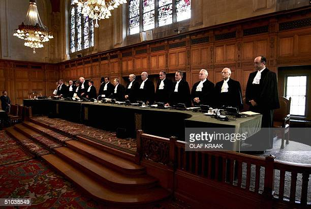 The judges of the International Court of Justice take place 09 July 2004 in The Hague President Shi Jiuyong of the ICJ will read the ruling about the...
