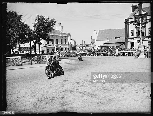The Junior TT Race passes through Ramsey on the Isle of Man 7th June 1950 Number 69 is W J Evans on AJS and Number 90 is Charlie Brett on Velocette