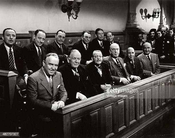 The jury appear favourablydisposed in a courtroom scene from the film 'Roxie Hart' 1942